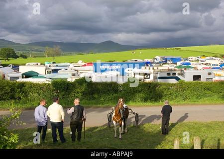 caravans under a dark sky appleby horse fair uk - Stock Photo