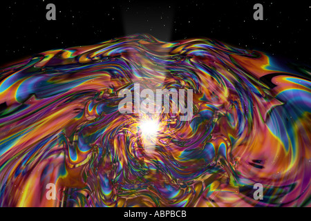Imaginary view of a singularity a spinning disk around a black hole emitting radiation from the center - Stock Photo