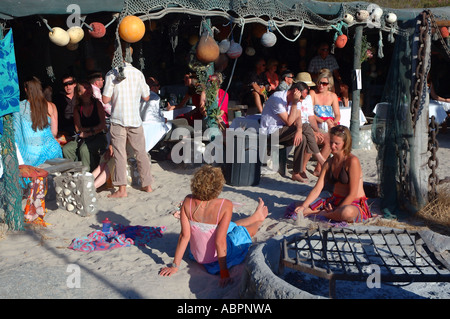 Relaxed young crowd at rustic beachside restaurant, Langebaan, Western Cape, South Africa - Stock Photo