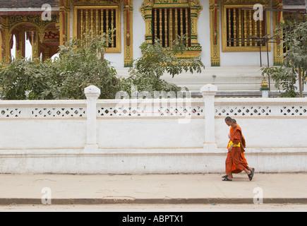 Monks Walking Along Pavement Outside Royal Palace Museum - Stock Photo