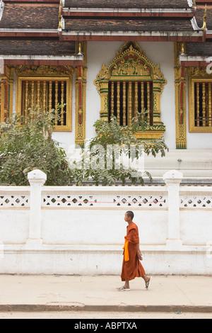 Monk Walking Along Pavement Outside Royal Palace Museum - Stock Photo