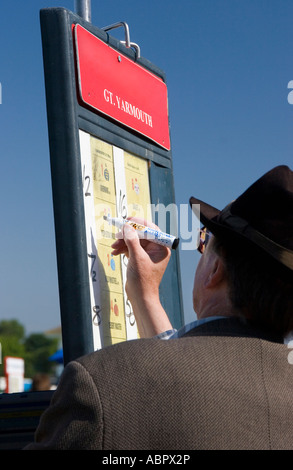 Bookmaker marks out odds on board at Great Yarmouth races (May 2007) - Stock Photo