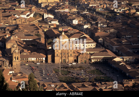 Cusco, Peru. View of the Plaza de Armas including La Compania church and the University entrance. - Stock Photo