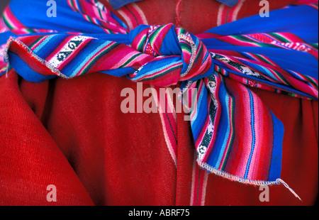 Close up of shawl tied around Quechua speaking man in tribal costume Tarabuco Sunday market Bolivia South America - Stock Photo