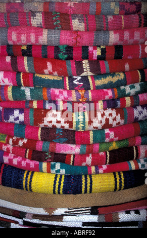 A stack of Bolivian woven woollen textiles as sold in La Paz Sucre Tarabuco and Potosi Bolivia South America - Stock Photo