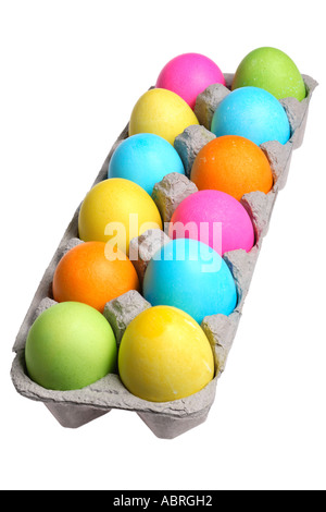 Colorful dyed easter eggs in carton. - Stock Photo