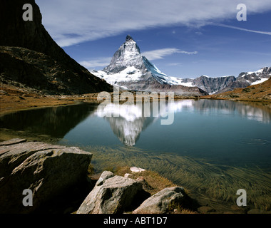 CH - SWITZERLAND: The Matterhorn and lake Riffelsee in foregound - Stock Photo