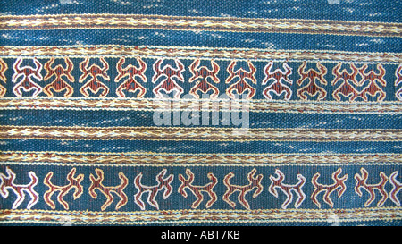 CHINA Embroidered backstrap loom woven textile with frog and animal motifs on an indigo ground cloth From Hainan - Stock Photo
