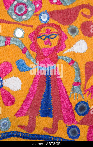 Detail of an embroidered wall hanging Textile from Rajahstan India Dancing woman - Stock Photo