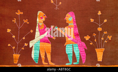 Detail of an embroidered Pulkhari textile from India Depicting Indian women in Saris - Stock Photo