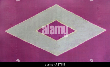 Ceremonial cloth and sacred heirloom Dodot Silk plangi decorated textile from Lampung Sumatra Indonesia - Stock Photo