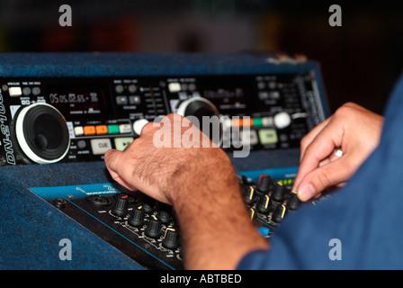 DJ Using an Electronic Mixer, Close Up. - Stock Photo