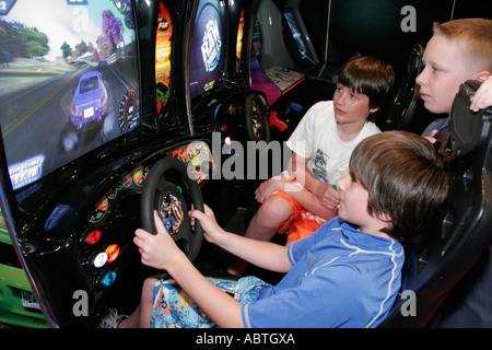 New York Atlantic Ocean Holland America Line ms Noordam video arcade boys simulated driving - Stock Photo