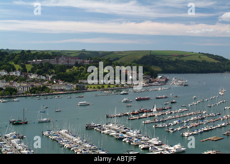 Marina at Kingswear with Brittania Royal Naval College Dartmouth on Hill in Background Devon England United Kingdom - Stock Photo