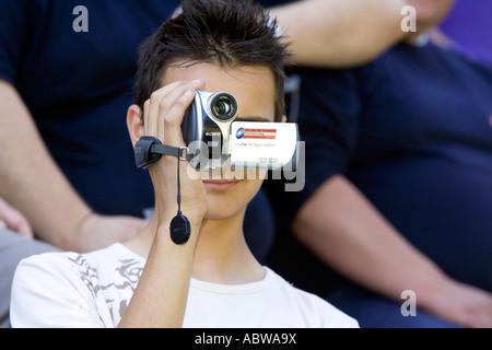 boy from the public takes photos digital camera - Stock Photo