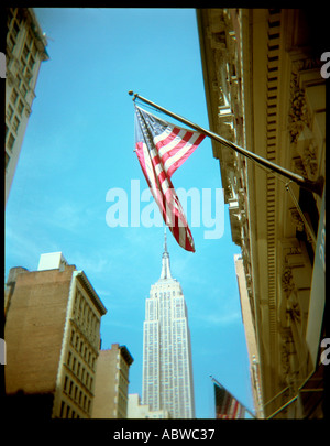 An American flag on 5th Avenue in New York. - Stock Photo