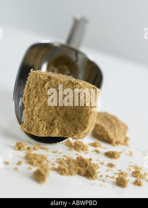 muscovado sugar and scoop - Stock Photo