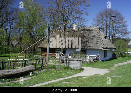 Crane well in Zagroda Guciow farm open air folk museum in Roztocze region Poland - Stock Photo
