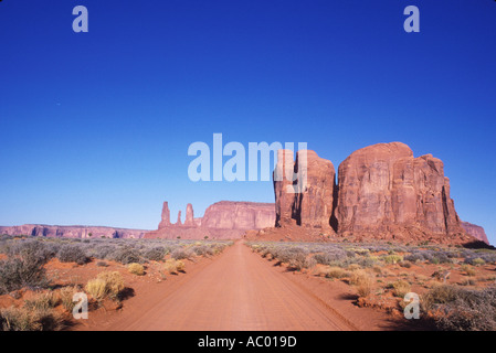 Dirt road leading to Monument Valley Utah - Stock Photo