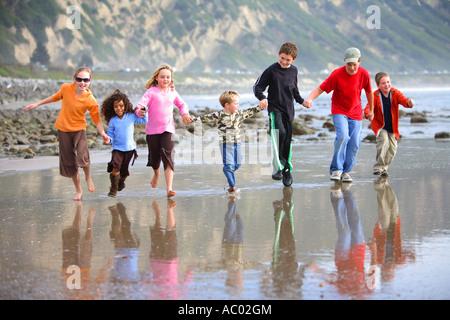 Children Running on Beach Santa Barbara, Santa Barbara County California United States MR - Stock Photo