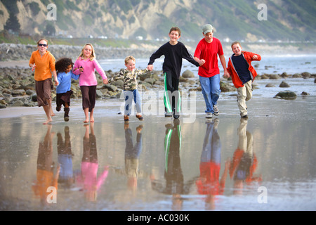 Children Running on Beach Mussel Shoals Carpenteria Santa Barbara County California United States - Stock Photo