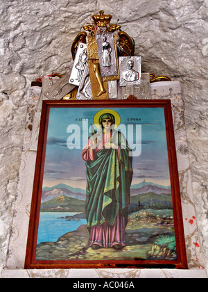 saint eirini irene holding wooden cross silver offerings old church crete krete island greece stock