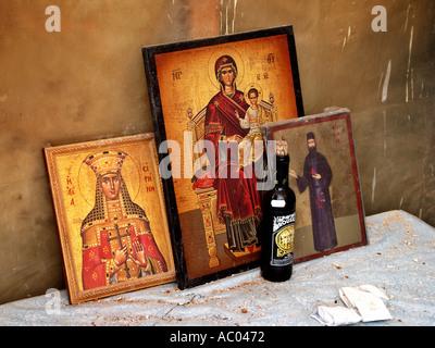 Saint Irene Irini Eirini Virgin Mary and child Jesus unknown Saint red wine on table old church Crete Krete island - Stock Photo