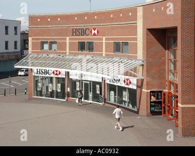 Aerial birds eye view of HSBC bank branch providing banking facility premises in seaside resort shopping high street - Stock Photo