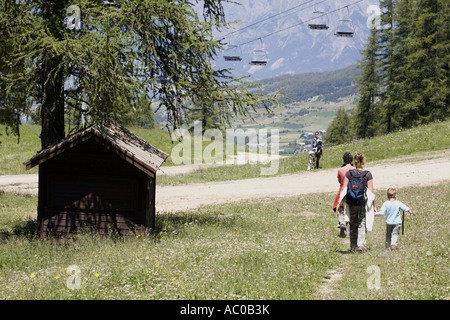 Tourists walking in a ski resort in summer Les Orres, Hautes Alpes, France - Stock Photo