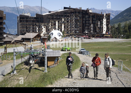 Tourists walking in a ski resort in summer, Les Orres, Hautes Alpes, France - Stock Photo