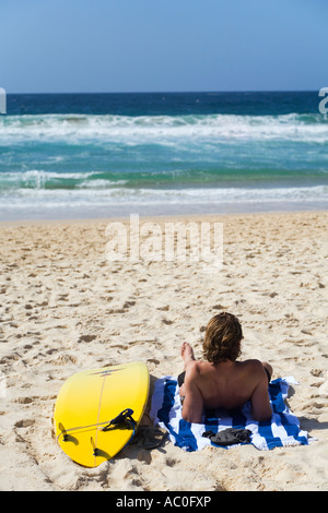 A surfer looks out over the sea at Bondi on Sydney's eastern beaches