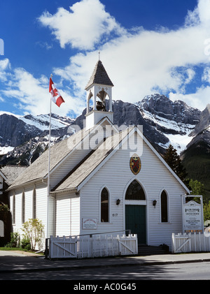 RALPH CONNOR UNITED CHURCH 1891 in downtown with Rocky Mountains beyond. Canmore Alberta Canada - Stock Photo