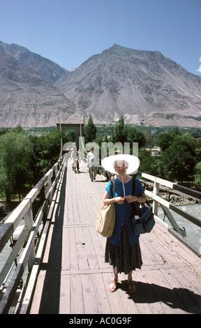 Pakistan Azad Kashmir Gilgit western tourist on suspension bridge - Stock Photo