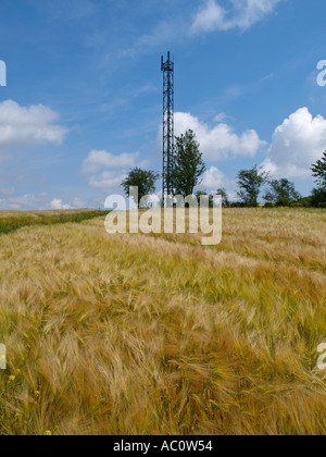 GSM cellular mobile phone communication transmitter network antenna mast on top of a hill in rural France Haute - Stock Photo