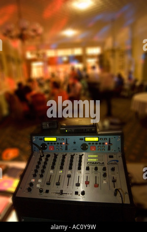 a dj booth with cd decks getting ready to entertain people at a wedding party - Stock Photo