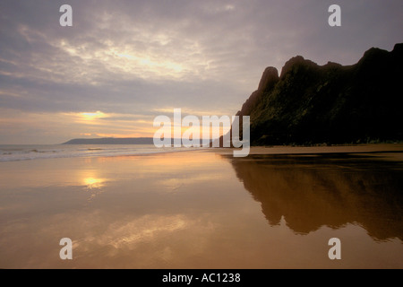 Evening sunset on the beach at Three Cliffs Bay Oxwich near Swansea Gower Peninsula South Wales GB Great Britain - Stock Photo