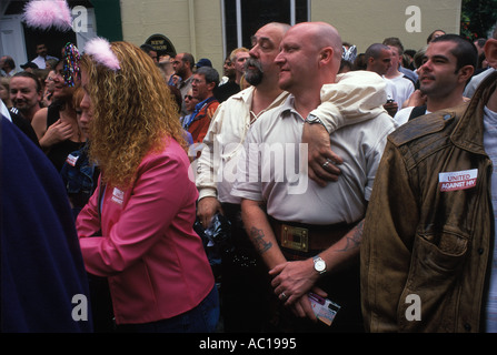 Gay Festival Manchester Pride Festival 1990s UK. Two big men known as 'bears' in crowded street watching parade. - Stock Photo