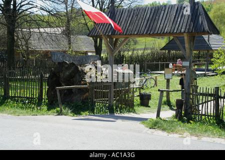 Entrance gate to Zagroda Guciow farm open air folk museum in Roztocze region Poland - Stock Photo