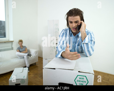 Man argueing at mobile phone - Stock Photo