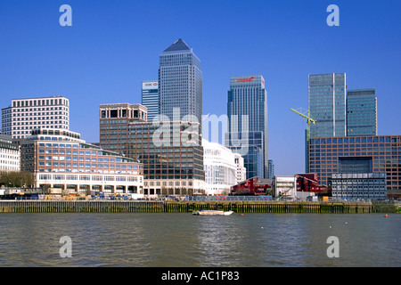 Canry Wharf and surrounding buildings on the Isle of Dogs seen from the Thames River in London. - Stock Photo