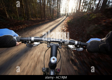 Handle bar of driving mountain bike, blurred motion - Stock Photo