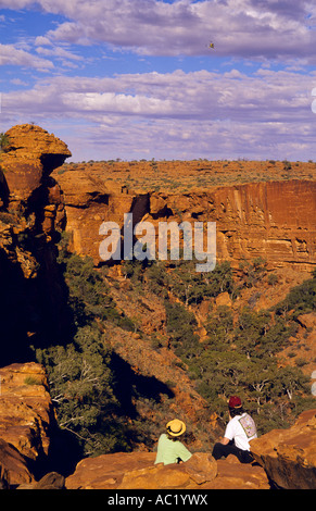 Walkers at lookout on north rim of canyon, Watarrka (Kings Canyon) National Park, Northern Territory, Australia, - Stock Photo