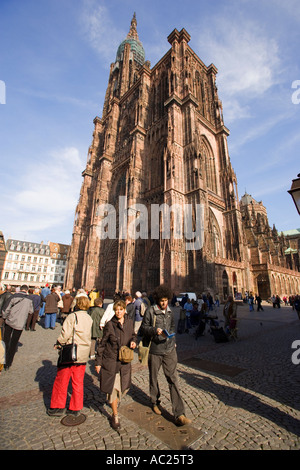 Tourists at Cathedral Square in front of the Our Lady s Cathedral Cath drale Notre Dame Strasbourg Alsace France - Stock Photo