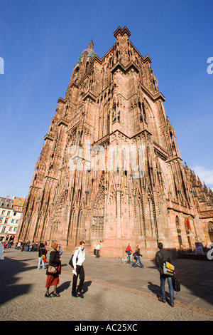 Tourists at Cathedral Square in front of the Our Lady s Cathedral Cathédrale Notre Dame Strasbourg Alsace France - Stock Photo
