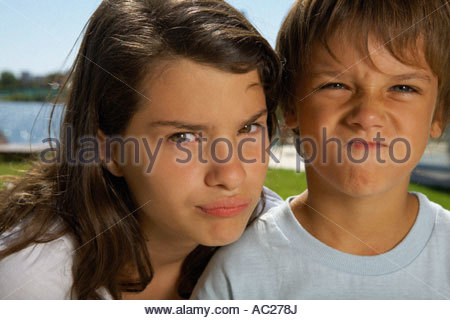 Boy and girl making faces - Stock Photo