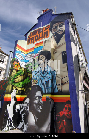 Faces of American Soul singer James Brown in graffiti on the back of terraced houses in Brighton UK - Stock Photo