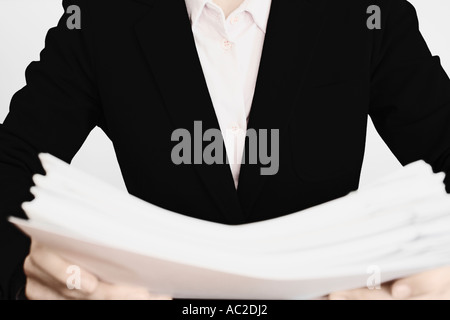 Businesswoman Holding Stack Of Documents - Stock Photo