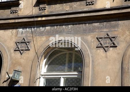 close up of bet hamidrash of Kovea Itim LTora 1810 building with star of david and writing hebrew symbols krakow - Stock Photo