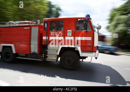 polish fire brigade fire guard straz krakow speeding past on way to fire - Stock Photo