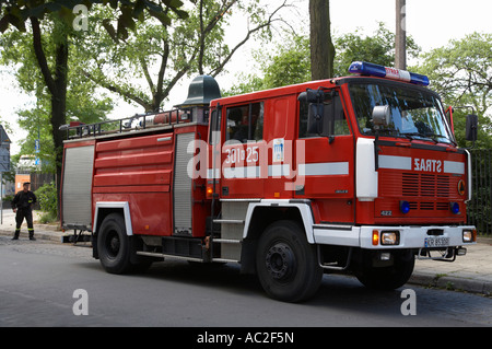polish fire brigade fire guard straz krakow vehicle parked in city street attending emergency call out - Stock Photo